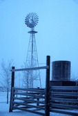 TALL AERMOTOR WINDMILL IN SNOWSTORM, HIGH PLAINS OF TEXAS