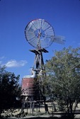 OLD WOODEN ECLIPSE WINDMILL STILL IN OPERATION ON THE TEXAS PLAINS