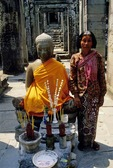 A CURRENT SHRINE WITH A SAFFRON-CLOTHED BUDDHA, ANGKOR THOM, CAMBODIA