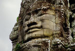 GREAT FACE ON A TOWER OF THE BAYON, ANGKOR THOM, CAMBODIA