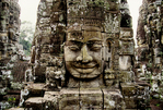 GREAT STONE FACES ON TOWERS OF THE BAYON, ANGKOR THOM, CAMBODIA