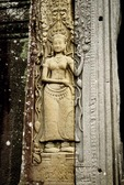 A DEVATA (FEMALE DIVINITY), ADORNING A WALL AT ANGKOR THOM, CAMBODIA