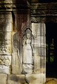 A DEVATA (FEMALE DIVINITY), ADORNING A WALL AT ANGKOR THOM, CAMBODIA