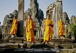 BUDDHIST MONKS. THE BAYON, ANGKOR THOM, CAMBODIA
