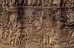 KHMER MILITARY PROCESSION WITH OX CARTS, BAYON, ANGKOR THOM, CAMBODIA