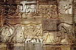 KHMER SOLDIERS STAGING A WILD BOAR FIGHT, BAYON, ANGKOR THOM, CAMBODIA
