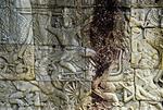 ASURA LEADER IN LION-DRAWN CHARIOT, THE BAYON, ANGKOR THOM, CAMBODIA