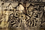 MAKING CERAMIC ROOF FINIALS, POURING BERRIES. THE BAYON, ANGKOR THOM, CAMBODIA
