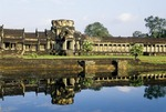 ENTRY TOWER TO ANGKOR WAT, REFLECTED IN THE SURROUNDING MOAT, CAMBODIA