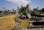 STONE BEASTS GUARD THE APPROACH TO ANGKOR WAT, CAMBODIA