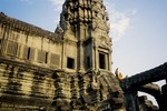 BUDDHIST MONKS DEPARTING THE SOUTHWEST TOWER, ANGKOR WAT, CAMBODIA