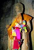 BRIGHTLY ADORNED IMAGE OF THE BUDDHA, ANGKOR WAT, CAMBODIA