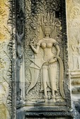 A DEVATA (FEMALE DIVINITY) ADORNS A WALL AT ANGKOR WAT, CAMBODIA