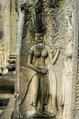 A DEVATA (FEMALE DIVINITY) ADORNS A WALL AT ANGKOR WAT, CAMBODIA