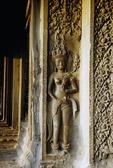 A DEVATA (FEMALE DIVINITY) ADORNS A WALL AT ANGKOR WAT; CAMBODIA