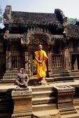 BUDDHIST MONK AT THE MANDAPA, BANTEAY SREI, CAMBODIA