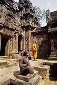 BUDDHIST MONK AT THE CENTRAL SANCTUARY, BANTEAY SREI, CAMBODIA