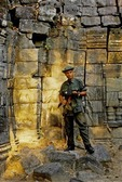 ARMED CAMBODIA SOLDIER STANDS GUARD AGAINST THEFT, TA SOM, ANGKOR, CAMBODIA