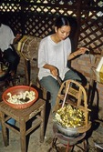 TRADITIONAL METHOD OF UNWINDING SILK FROM SILKWORM COCOON, SIEM REAP, CAMBODIA
