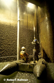 Removing Zebra Mussels by blasting with high-pressure water. Invasive Zebra Mussels (up to 750,000 per square meter) are attached to the walls of an underground screenhouse, part of the cooling system at the Detroit Edison Monroe Power Station.