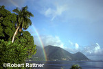 Rainbow over Caribbean. Soufriere, Dominica. Mountainous rain forest in background