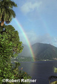 Rainbow over Caribbean. Soufriere, Dominica. Moutainous rainforest in background