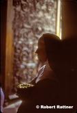 Nun inside doorway of Notre Dame Cathedral