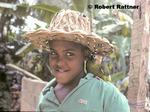 Boy with pet Hispaniolan Parrot