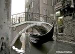 Gondola under bridge on Calle de Cavalletto