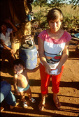 Woman holding gold dust on a lottery ticket - itinerant gold mining in the Pantanal -