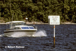 Boat speeding in slow speed manatee area in the Intracoastal Highway