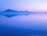 BONNEVILLE SALT FLATS, UTAH. USA. Silver Island Mountains at dawn reflected in shallow water on Bonneville Salt Flats. Great Salt Lake Desert. Great Basin.