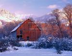 CACHE VALLEY, UTAH. USA. Barn below Bear River Range in winter. Cache Valley near Richmond. Great Basin.