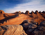 ARCHES NATIONAL PARK. Delicate Arch casts shadow at sunrise.