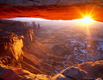 CANYONLANDS NATIONAL PARK, UTAH. USA. Mesa Arch at sunrise in winter. Island in the Sky.