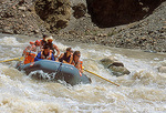 CANYONLANDS NATIONAL PARK, UTAH. USA. Boatman and passengers on raft in rapids in Cataract Canyon. Colorado River.