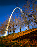 JEFFERSON NATIONAL EXPANSION NATIONAL HISTORIC SITE, SAINT LOUIS, MISSOURI. USA. Bare trees in late autumn below Gateway Arch.