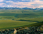 ARCTIC NATIONAL WILDLIFE REFUGE, ALASKA. USA. View of Sadlerochit River Valley and Romanozov Mountains from Sunset Pass in the Sadlerochit Mountains. North Slope.