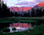 HIGH UINTAS WILDERNESS, UTAH, USA. Ostler Peak reflected in pond at sunset. Near headwaters of Bear River in Uinta Mountains.