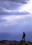 ALTA TOQUIMA WILDERNESS, NEVADA. USA.Hiker on middle summit of Mt. Jefferson below cumulus and altostratus clouds. Toquima Range. Toiyabe-Humboldt National Forest.