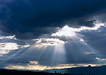 GRAND TETON NATIONAL PARK, WYOMING. USA. Crepuscular rays shining through stratocumulus clouds. Snake River Valley.