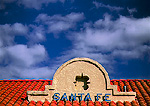 SANTA FE, NEW MEXICO. USA. Southwest architecture, roof of Santa Fe Railroad Depot below cumulus clouds. Rio Grande Valley.