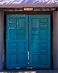 Doors at El Zaguán, historic 19th century Territorial hacienda on Canyon Road, built by wealthy merchant.