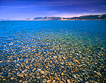 UTAH. USA. Stony lakebed of Bear Lake is revealed by very clear water. South shore near Rendezvous Beach.