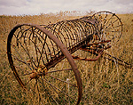 IDAHO. USA. Old hay rake in field near Preston.