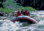 FRANK CHURCH RIVER OF NO RETURN WILDERNESS, IDAHO. USA. Women enjoy ride on raft on Middle Fork Salmon River. Middle Fork Salmon Wild & Scenic River.