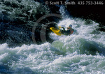 FRANK CHURCH RIVER OF NO RETURN WILDERNESS, IDAHO. USA. Kayaker playing in Marble Creek Rapid on Middle Fork Salmon Wild & Scenic River.
