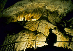 CARLSBAD CAVERNS NATIONAL PARK, NEW MEXICO. USA. Hiker silhouetted against cave formations. Carlsbad Cavern.