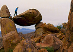 BIG BEND NATIONAL PARK, TEXAS. USA. Hiker walks on a balanced rock.