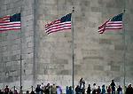 WASHINGTON, D.C. USA. Tourists & flags at base of Washington Monument.